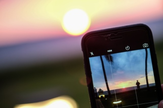 Taking picture of taking picture of sunset, Sri Lanka