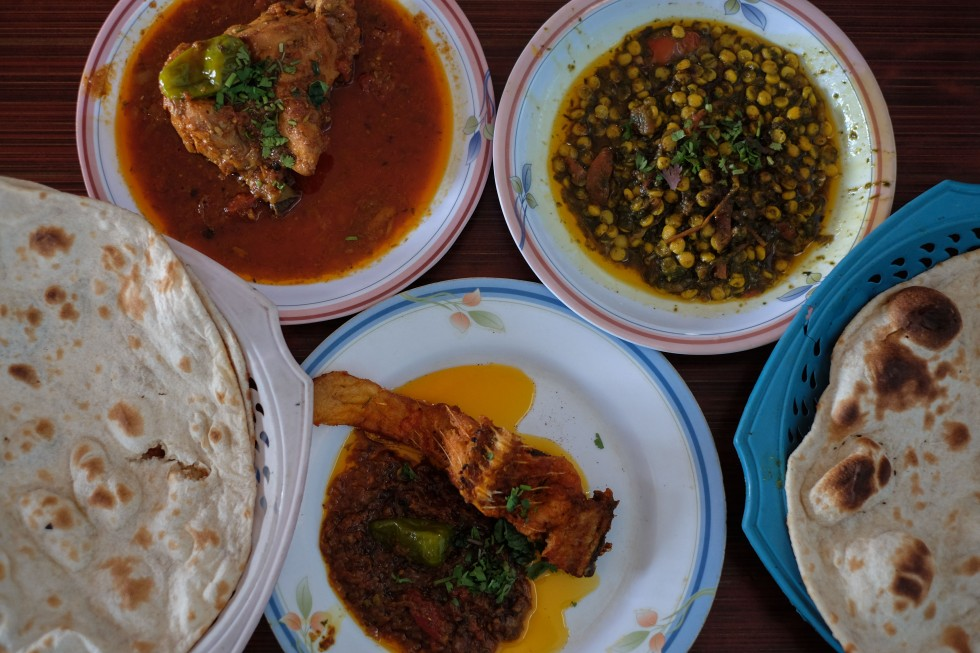 Fish, chiken, lentils, roti and naan at a roadside restaurant in Thatta. Delicious Pakistani food